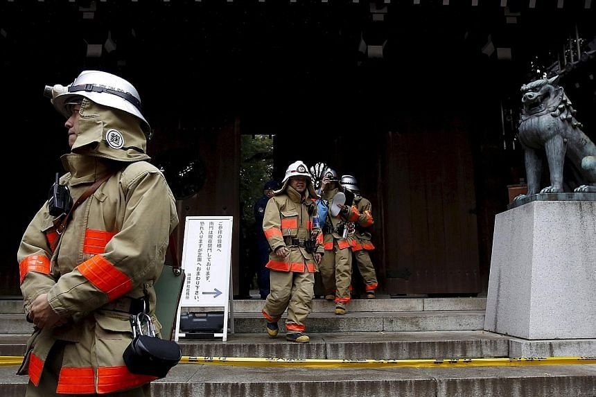 Firemen at the Yasukuni Shrine after a blast on its premises in Tokyo, Japan, on Nov 23. The explosion happened in a men's washroom. No one was hurt.