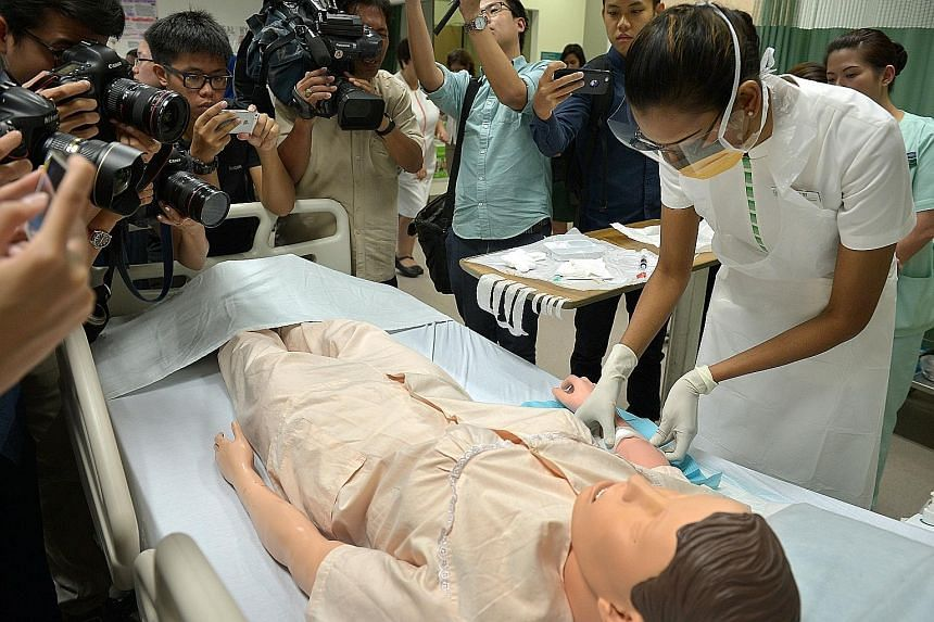 A nurse giving a demonstration on patient safety and infection control measures at SGH in October during a media tour. An independent committee found that poor infection control caused the hepatitis C outbreak there earlier this year. Some 25 kidney