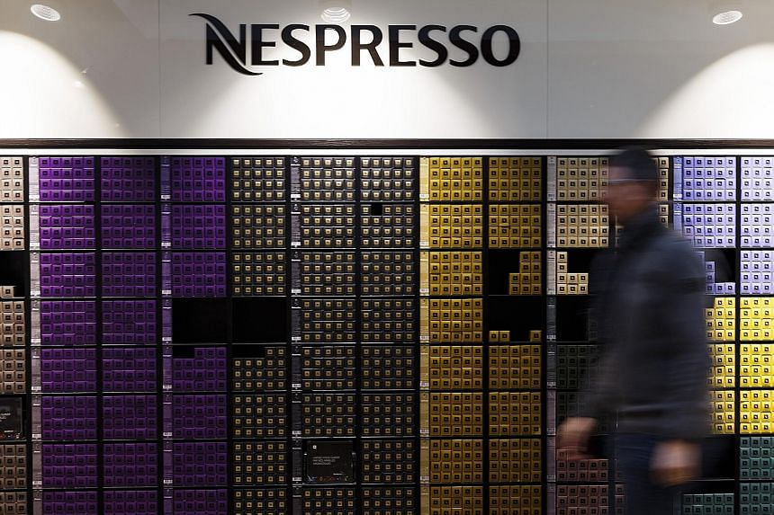 A display of Nespresso coffee capsules at the Nestle SA headquarters in Vevey, Switzerland. Nespresso sells its products in its own boutiques, which are modelled after luxury stores.