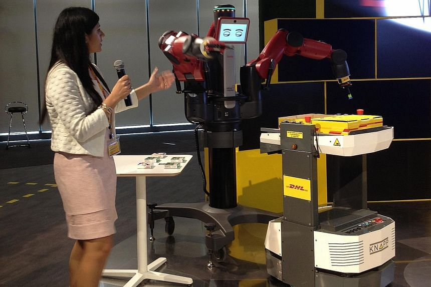 Guests at the launch of the centre were able to see Mr Baxter, a pick-and-pack robot, placing packets of Panadol into a DHL parcel.