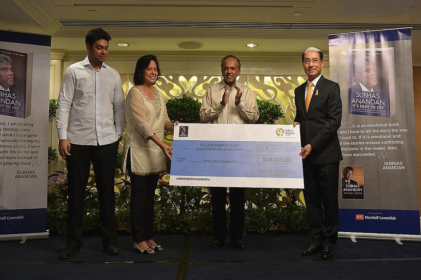 (From left) The late Mr Subhas Anandan's son and wife - Mr Sujesh Anandan and Mrs Vimala Anandan - with Law Minister K. Shanmugam and vice-chairman of the Yellow Ribbon Fund Lucas Chow at the launch of the book It's Easy To Cry yesterday. The book ha