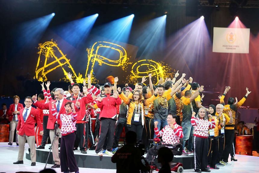 Athletes from various competing nations joining in a performance during the closing ceremony of the 8th Asean Para Games at the Sands Grand Ballroom on Dec 9, 2015.