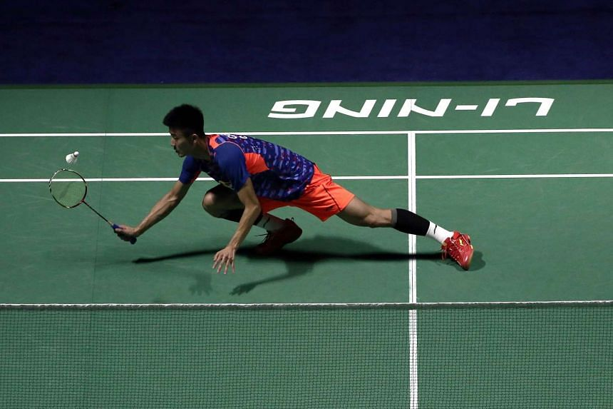 Chen Long of China hits a return against Ajay Jayaram of India during their men's singles first round match at the China Open badminton tournament in Fuzhou, China, on Nov 11, 2015.