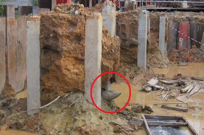 SAF's Explosive Ordnance Disposal team was called in when a projectile was found at a construction site in Senoko Drive.