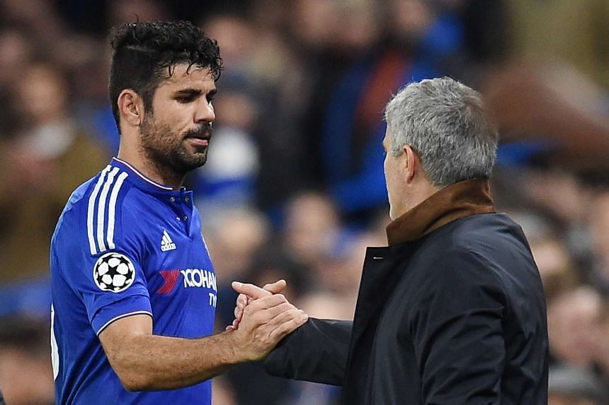 Mourinho shakes hands with Costa as he comes off the pitch on Dec 9, 2015.