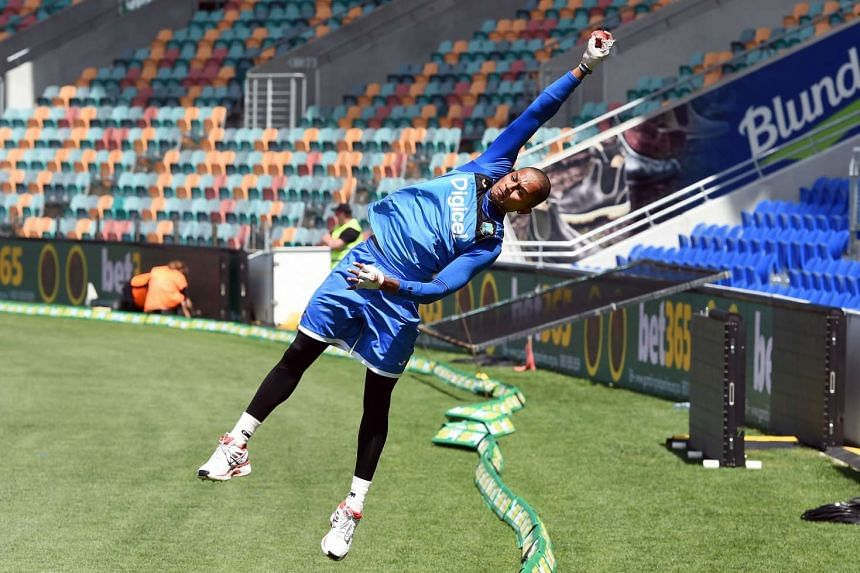 West Indies cricketer Shane Dowrich catches the ball on the boundary in a training session before the first cricket Test match against Australia in Hobart on Dec 9, 2015.