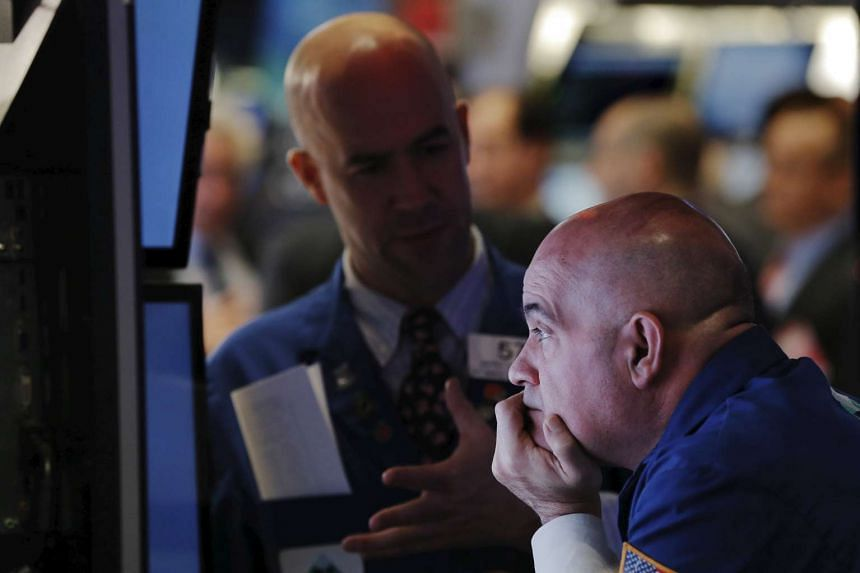 A trader works on the floor of the New York Stock Exchange shortly after the opening bell in New York. PHOTO: REUTERS