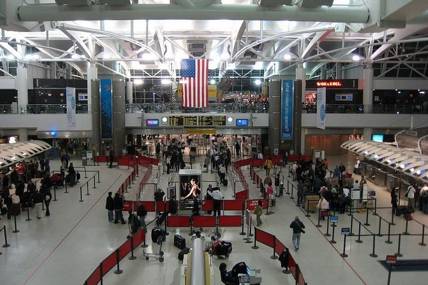 Hong Yang, 55, had attempted to bribe the officer after arriving at JFK International Airport.