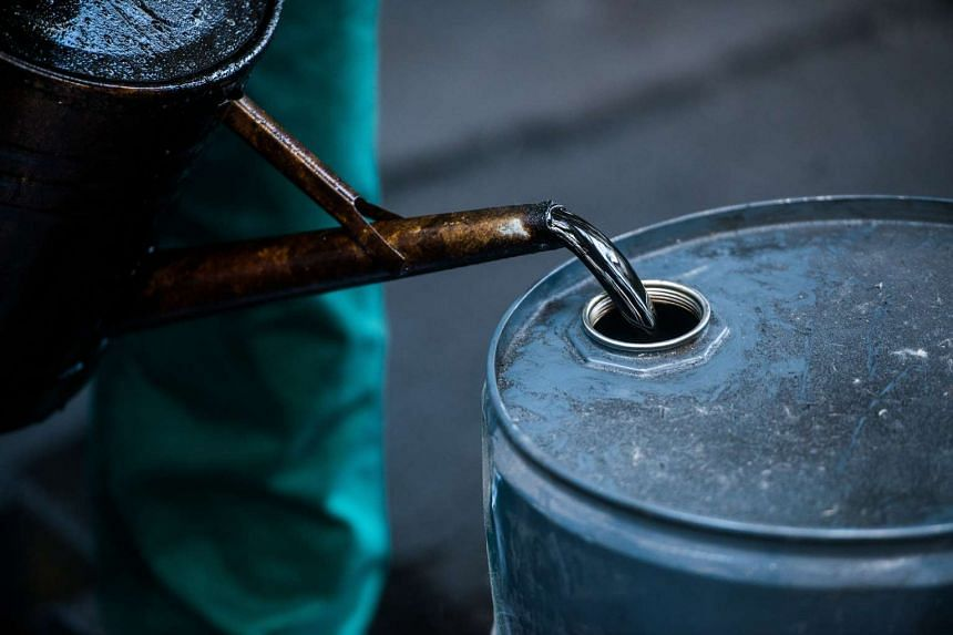 A worker pouring oil into a barrel at a refinery in Hungary in 2013.