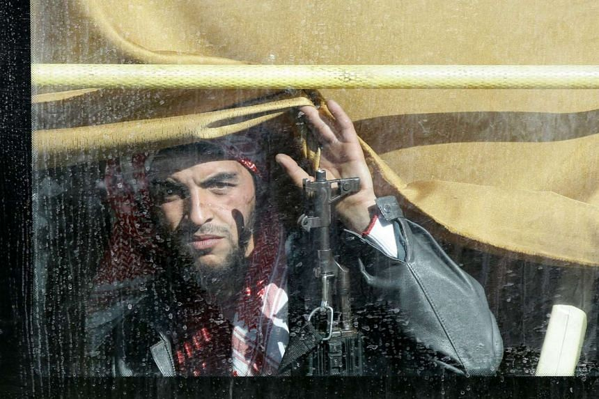 A Syrian rebel fighter being evacuated from Homs.