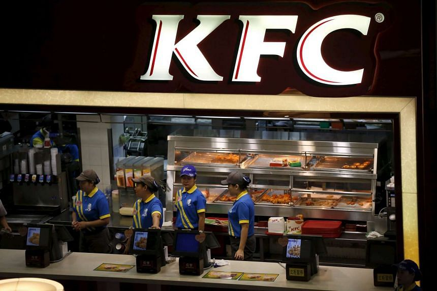 Employees work at a KFC store in Shanghai in this July 29, 2014 file photo.