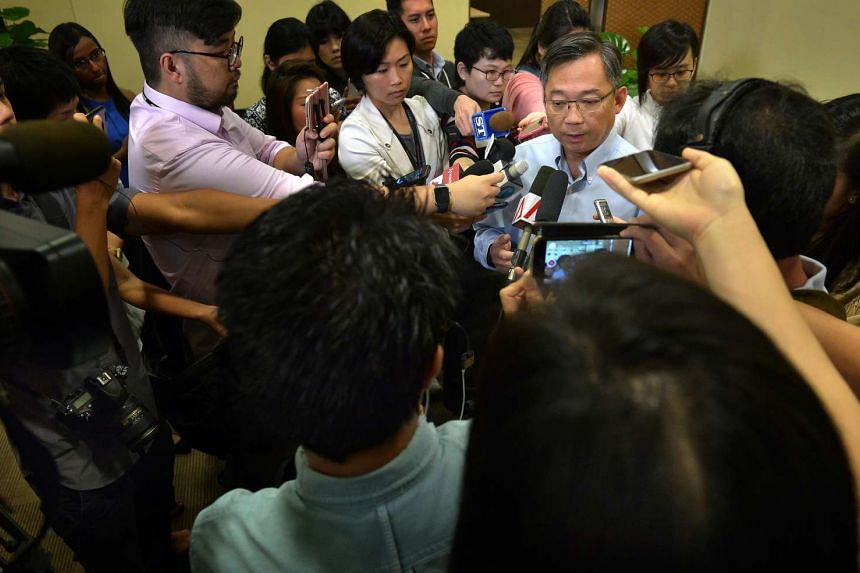 Health Minister Gan Kim Yong speaking to reporters on Dec 8, 2015, following the release of the report from the Independent Review Committee on the hepatitis C outbreak at Singapore General Hospital.