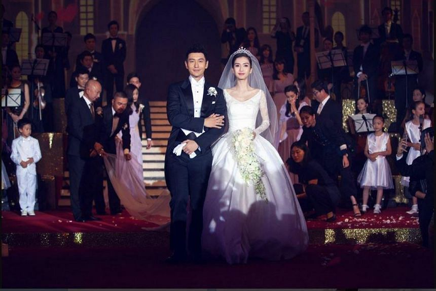 Chinese actor Huang Xiaoming and his actress wife Angelababy (both above) at their wedding in October.