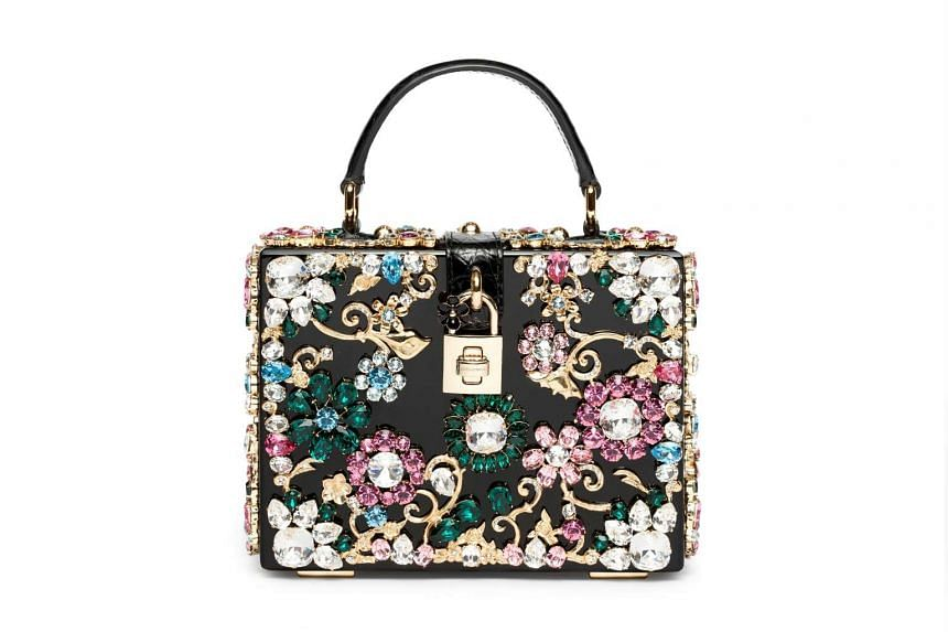 For that special occasion: the mini bag embellished with crystals and faux gems from Dolce & Gabbana's Fall Winter 2015/16 collection (above), $10,900, available at Dolce & Gabbana stores including 01-24/02-12 Ion Orchard and 01/60/61/62 and B1-138