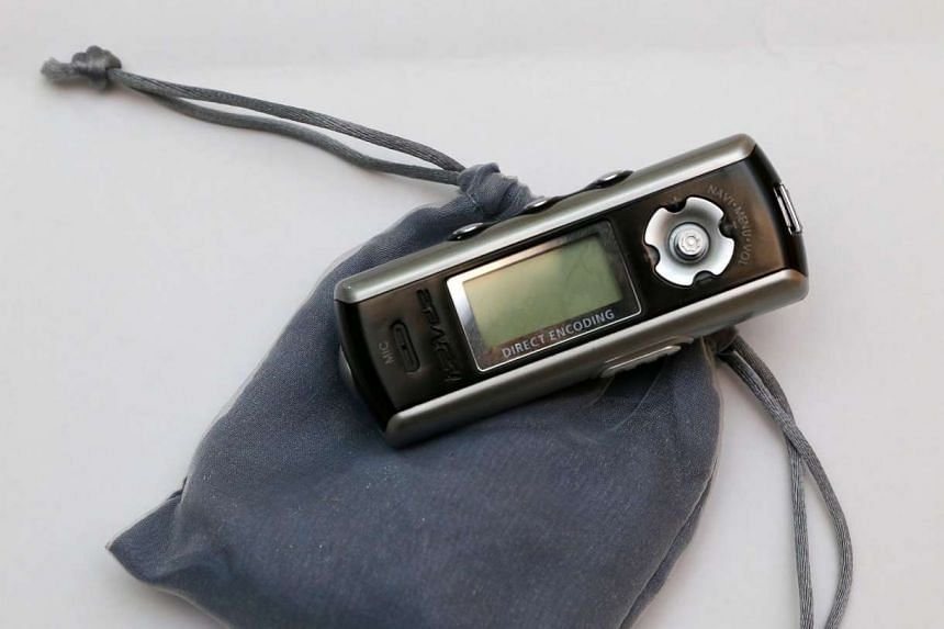 Things in her bag: IRIVER MP3 PLAYER - I have all genres of music in here, from classical to pop. I use this on long-haul flights.
