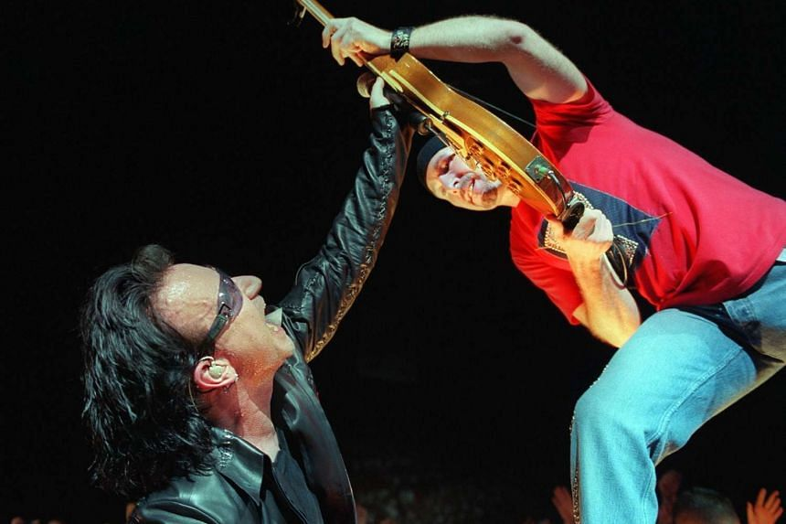 U2's group members Bono (left) and The Edge performaing during a concert.