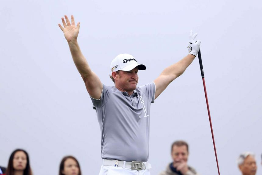 Jamie Donaldson of Wales reacts after tee off on the 15th hole.