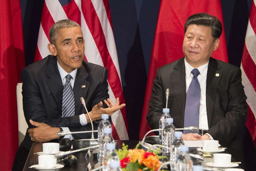 US President Barack Obama and Chinese President Xi Jinxing during a bilateral meeting ahead of COP21.