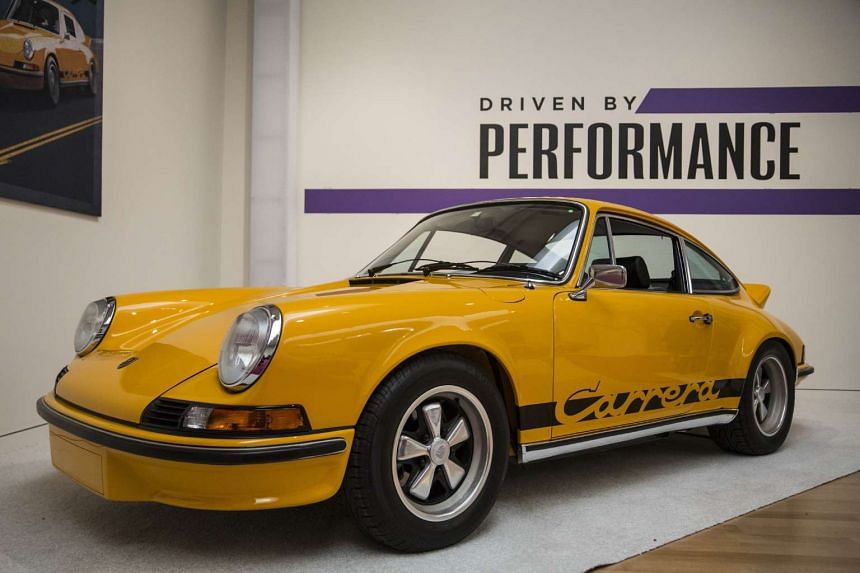 """A 1973 Porsche 911 Carrera RS 2.7 Touring on display at Sotheby's during a press preview before the """"Driven by Disruption"""" auction on Dec 4 in New York."""