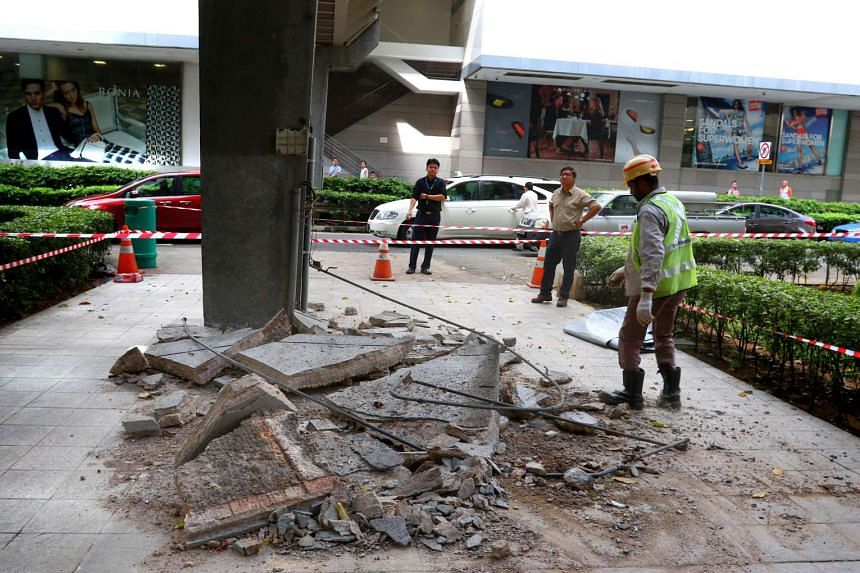 A slab of concrete fell from a pedestrian bridge outside Orchard Plaza on Wednesday morning.