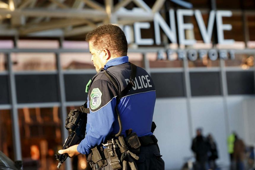 A Swiss police officer patrols at the Geneva airport during a high level of alert in Geneva.