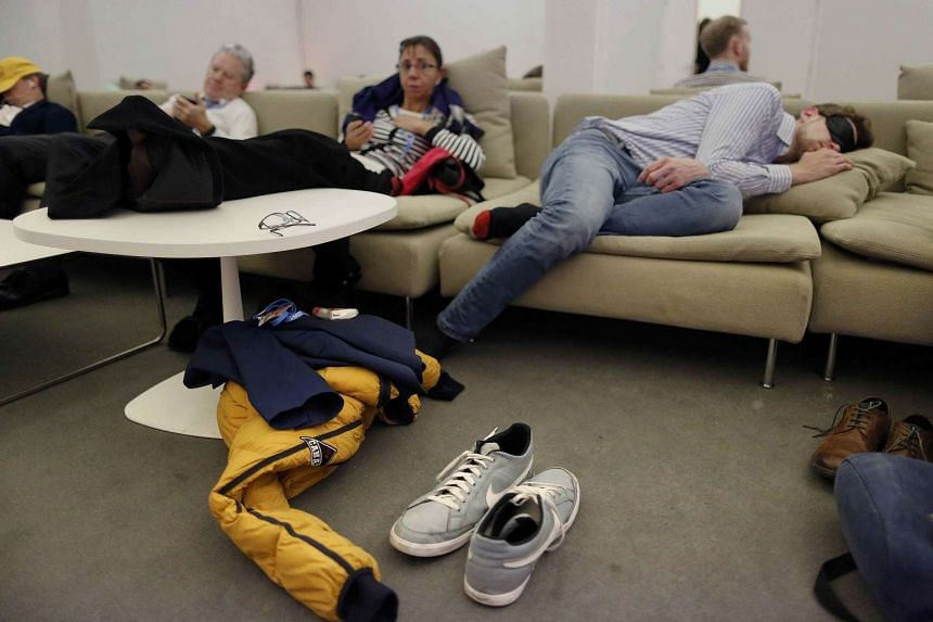 Observers take a rest during the World Climate Change Conference 2015 (COP21).