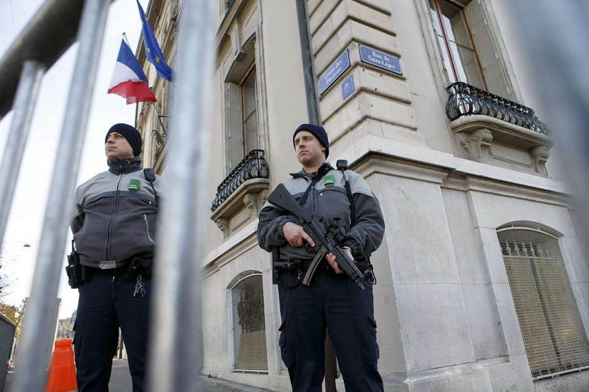 Swiss police officers control the area in front of the consulate of France, due to a high level of alert, in Geneva, Switzerland.