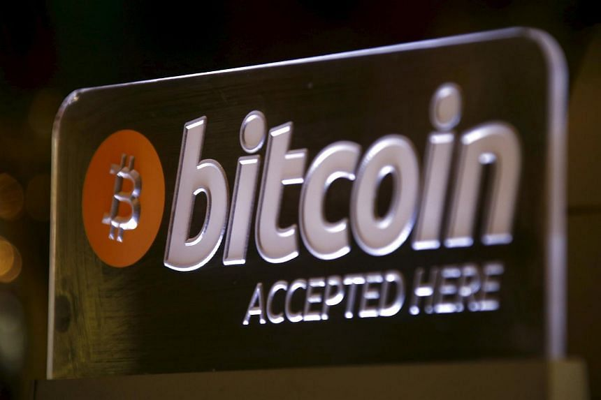 A Bitcoin sign displayed at a bar in Sydney on Sept 29.