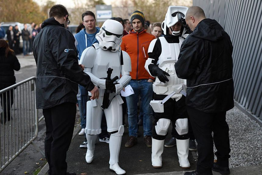 Security guards searching fans dressed as Stormtroopers at an unofficial Star Wars convention in Manchester on Dec 4.