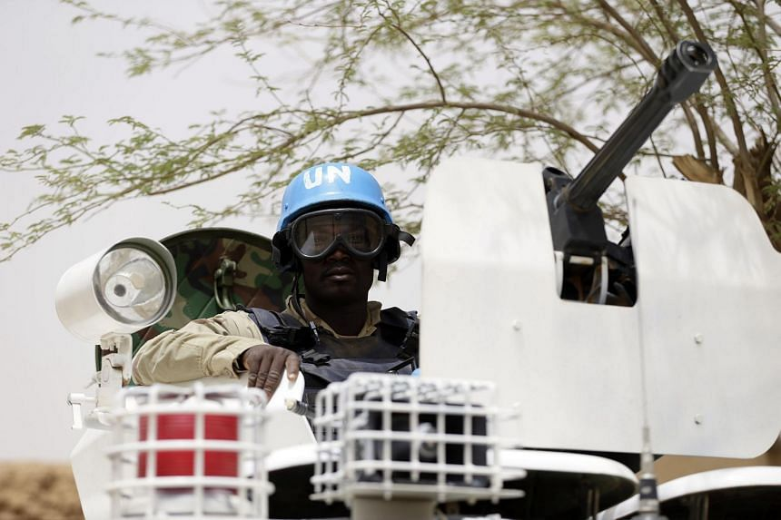 United Nations soldiers are seen patrolling in the northern Malian city of Kidal in this July 27, 2013 file photo.