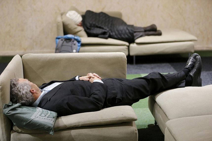Participants resting at the World Climate Change Conference 2015 in Le Bourget, France, on Dec 10.
