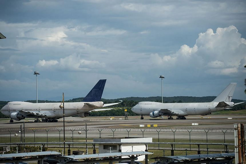 Two of the three aircraft seen parked at Kuala Lumpur International Airport on Dec 8.