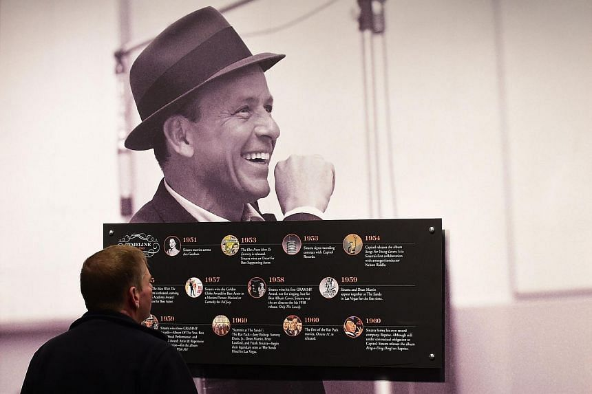 A man views a Frank Sinatra exhibition at the Grammy Museum in Los Angeles on Nov 30, 2015.