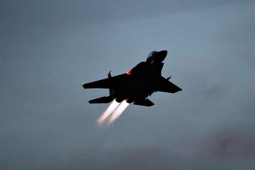 An RSAF F15 performing a full afterburner takeoff during a night mission.