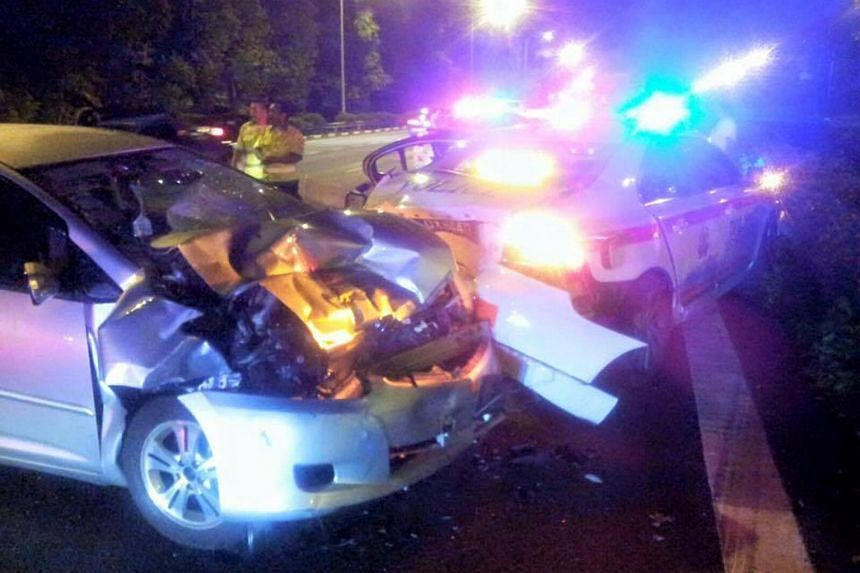 A car collided into the rear of a Traffic Police car and an enforcement motorcycle on Thursday.