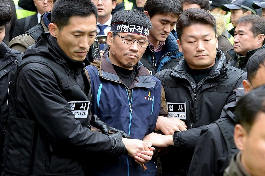 Han Sang Gyun (centre), head of one of South Korea's two main labour groups, holed up in a Buddhist temple for almost four weeks to avoid arrest for organising an anti-government protest last month.