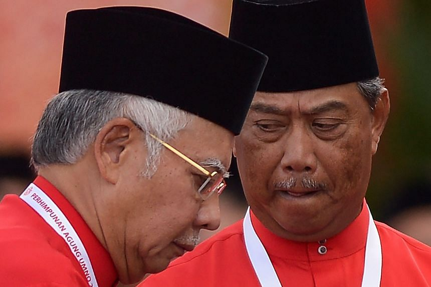 Prime Minister Najib Razak (left) and Umno deputy president Muhyiddin Yassin at the party's annual congress in Kuala Lumpur yesterday. Mr Najib has faced calls to resign for his handling of debt-burdened state investment firm 1MDB. There are also cal