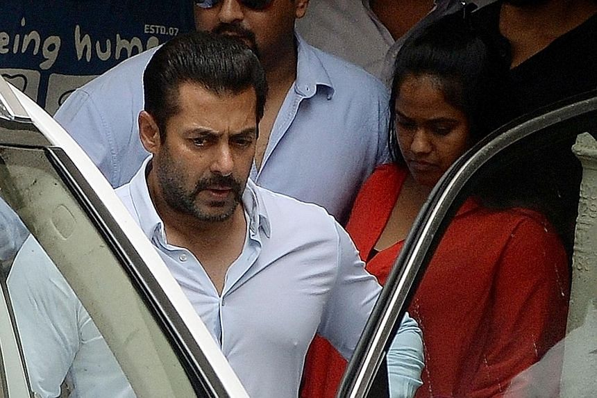 Salman Khan leaving his home before a court appearance in May. He had been convicted of culpable homicide and sentenced to five years in prison but won a High Court appeal yesterday.