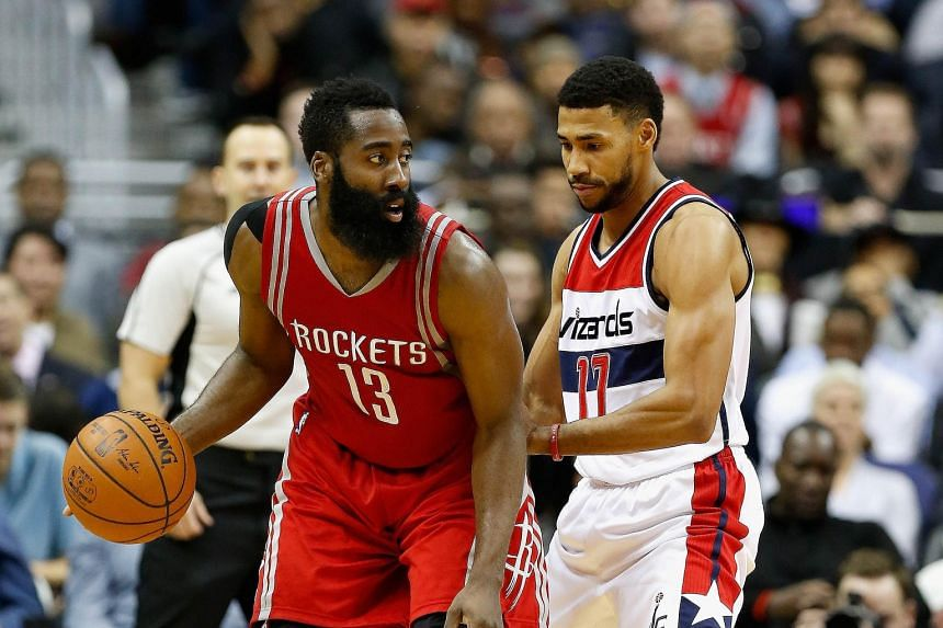 James Harden (left) of the Rockets working the ball against Garrett Temple of the Wizards during the second half in Washington. The visitors won 109-103, their fourth triumph in their last five games.