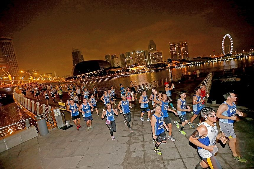 Participants at this year's ST Run passing city landmarks such as the Esplanade and Singapore Flyer. Next year's event will take runners past more of the stunning sights around the Marina Bay area.