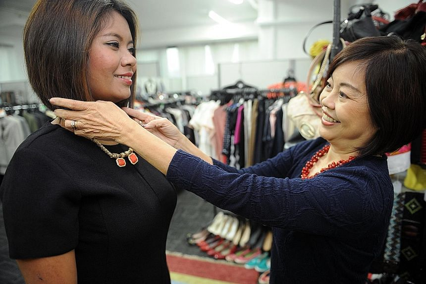 Ms Pang Li Kin, 63, who runs Image Mission, helping to accessorise Ms Nana, 28. The latter was referred to Image Mission and went for her first coaching session last week.