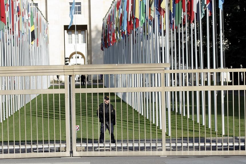 An armed security officer at the European headquarters of the United Nations in Geneva. The complex was evacuated on Wednesday night as security personnel conducted office-to-office searches.