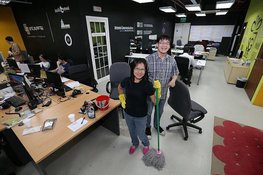 Ms Wendy Tay, who owns and runs a cleaning business, with Entrepreneurs with Disabilities co-founder Joseph Tay at the social enterprise's office.