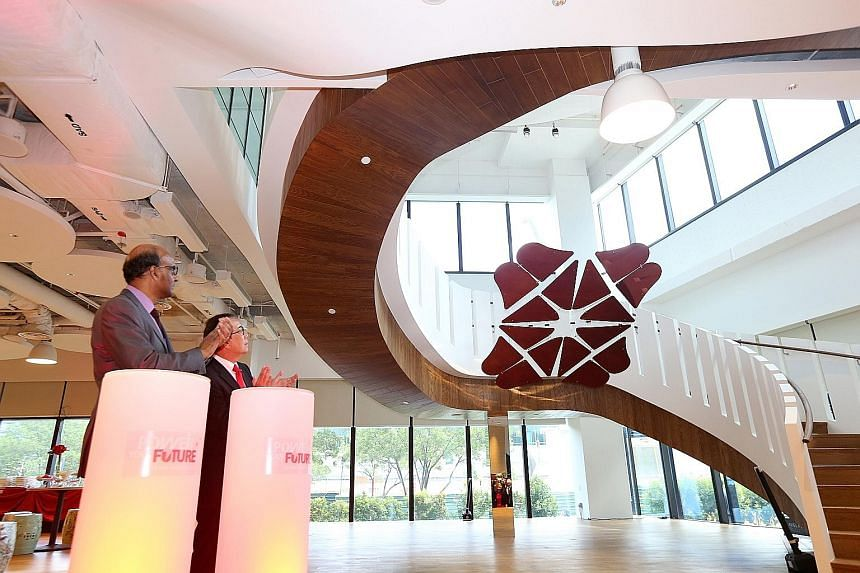 Deputy Prime Minister Tharman Shanmugaratnam and DBS chairman Peter Seah talked about digital and technology disruption in their speeches yesterday at the opening of DBS' new learning centre.