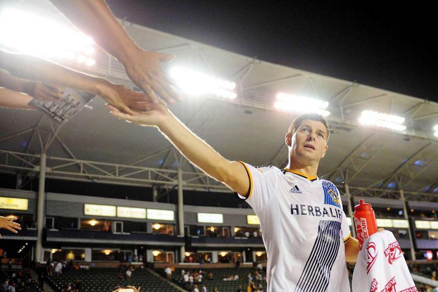 Los Angeles Galaxy midfielder Steven Gerrard greeting fans.