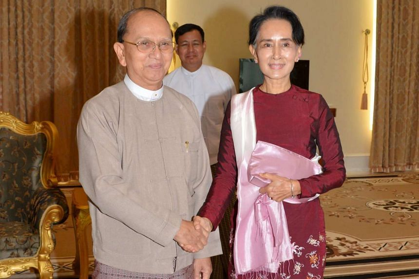 Myanmar's President Thein Sein shaking hands with National League for Democracy leader Aung San Suu Kyi in Naypyitaw on Dec 2.