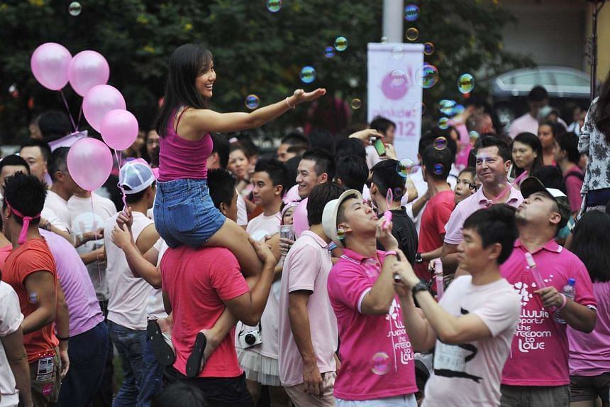 Participants the 2012 edition of Pink Dot, an event that champions for an open and inclusive society in Singapore.
