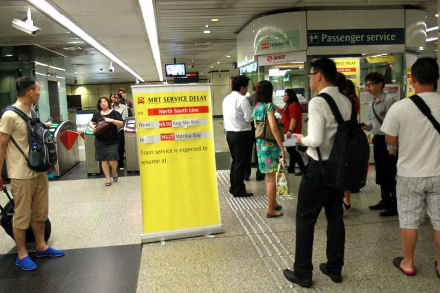 A sign at Braddell MRT station informing commuters of a delay on the North-South Line on Jan 21, 2014.
