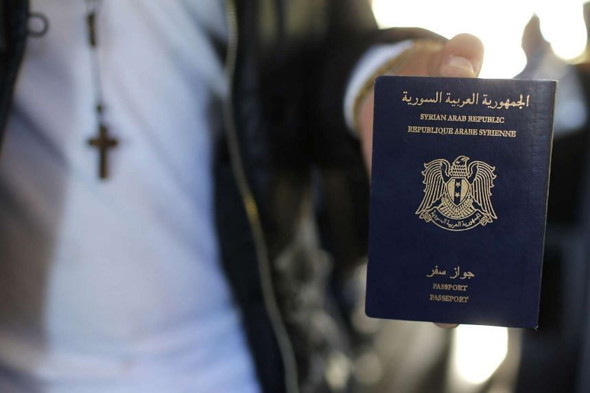 A Syrian refugee displaying his passport at the Charles de Gaulle Airport in France on Oct 2.