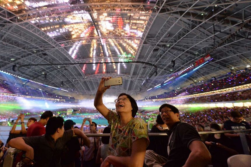 Spectators attending the 28th SEA Games closing ceremony at the National Stadium on June 16, 2015.